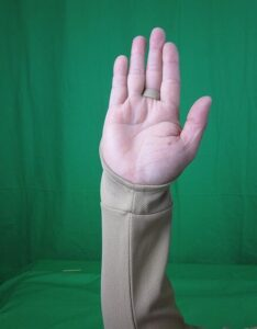 Driver Sun Protection Sleeve Beige closeup with the loop around the finger to hold it in place palm side
