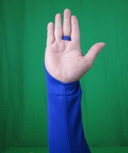 Driver Sun Protection Sleeve Royal Blue closeup with the loop around the finger to hold it in place palm side